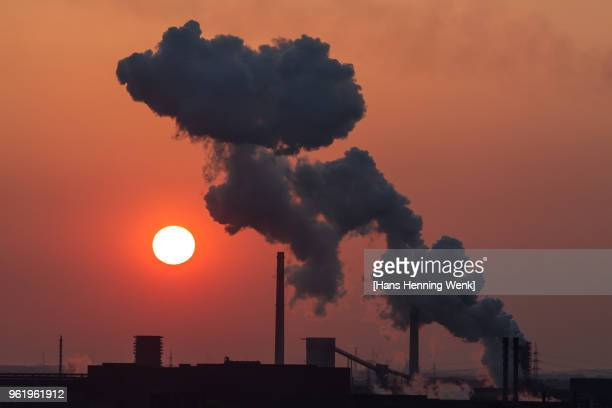 industrial skyline at sunset with steam cloud - fumes stock pictures, royalty-free photos & images