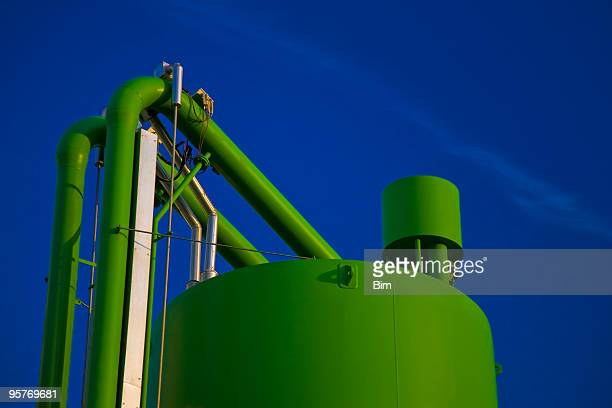 industrial storage tank and pipes against blue sky - factory farming stock pictures, royalty-free photos & images