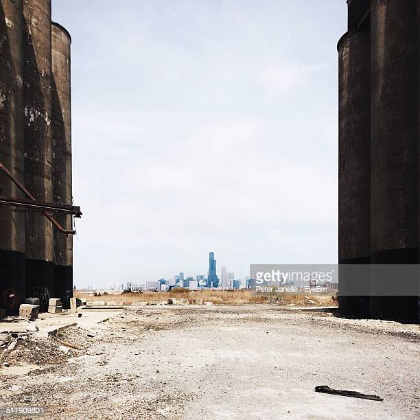 Industrial storage tanks with cityscape in background