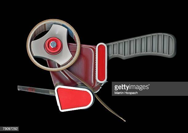 industrial tape dispenser - tape dispenser stock photos and pictures