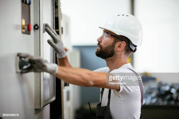 Industrial technician operating in electricity substation
