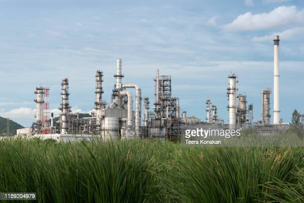 industrial view oil refinery and oil tanks plant during at twilight - oil refinery stock pictures, royalty-free photos & images