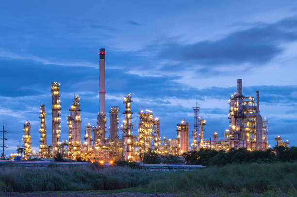 Industrial view Oil refinery and oil tanks plant during at twilight