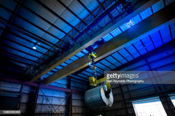 industrial warehouse - crane construction machinery stock pictures, royalty-free photos & images