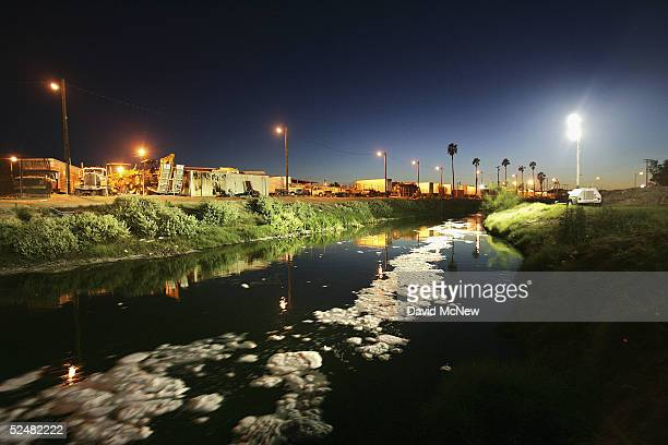 Industrial waste suds are carried by the New River reportedly the most polluted river in the US after flowing across the US/Mexico border from Mexico...