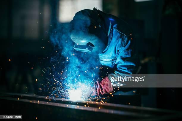 saldatore industriale - ferro foto e immagini stock