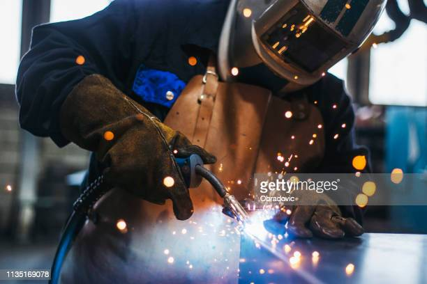 industrial welder with torch - industry stock pictures, royalty-free photos & images
