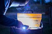 worker is welding steel part car