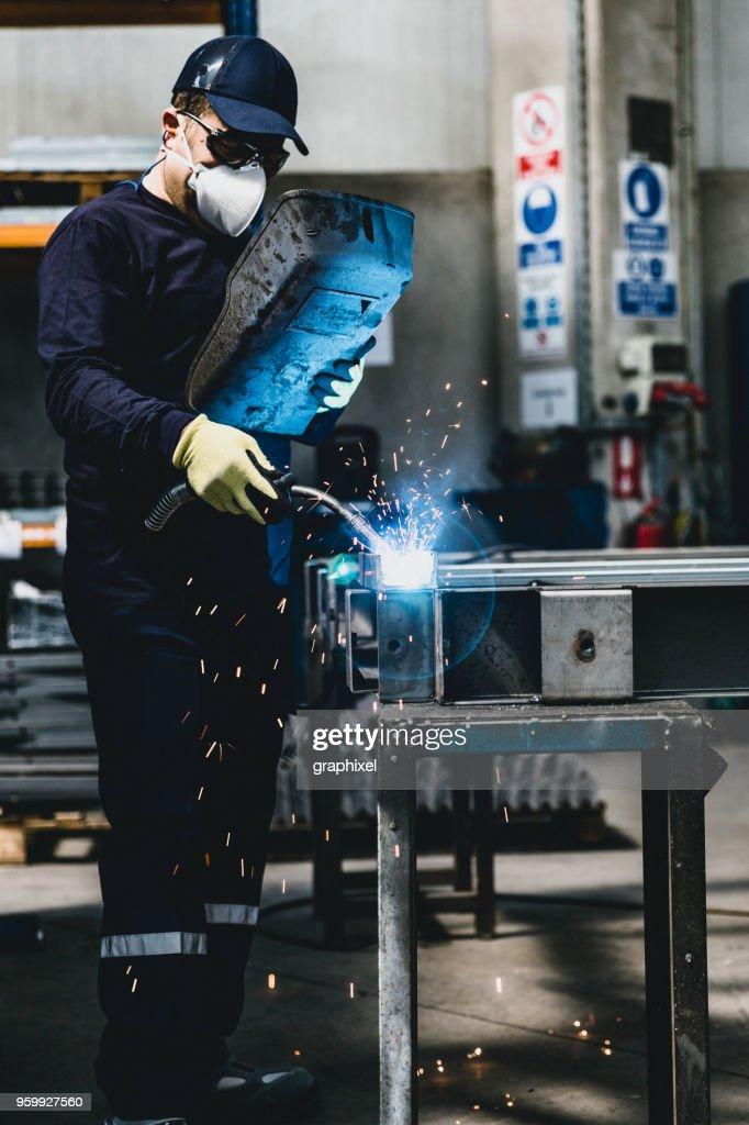 Industrial Welder With Welding Tool : Stock Photo