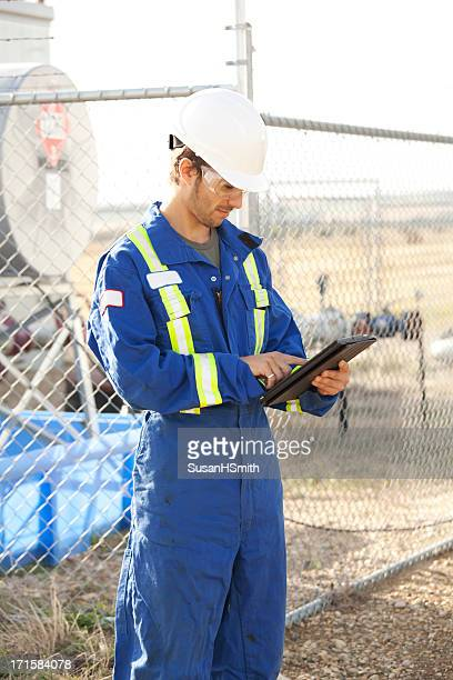 Industrial Worker At Industry Site With Digital Tablet