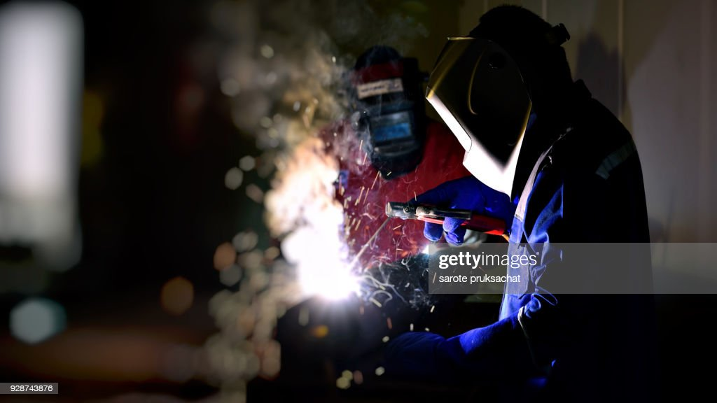 Industrial Worker at the factory welding close up . : Stock Photo