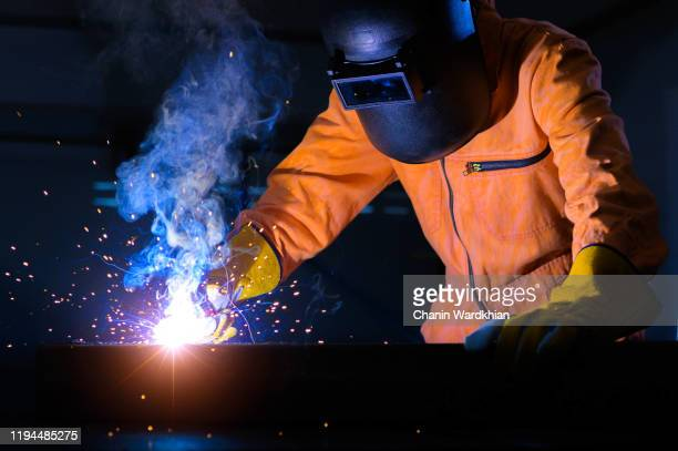 industrial worker at the factory welding - being fired photos stock pictures, royalty-free photos & images