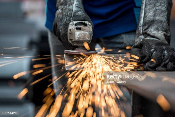 industrial worker cutting metal - stahl stock-fotos und bilder