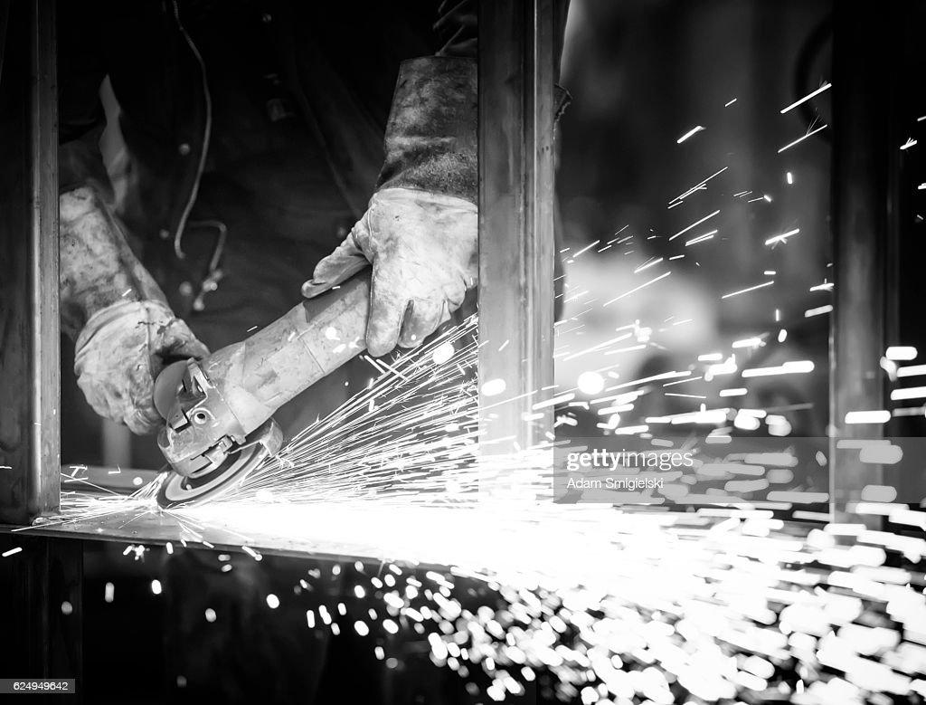industrial worker grinding steel in workshop : Stock Photo