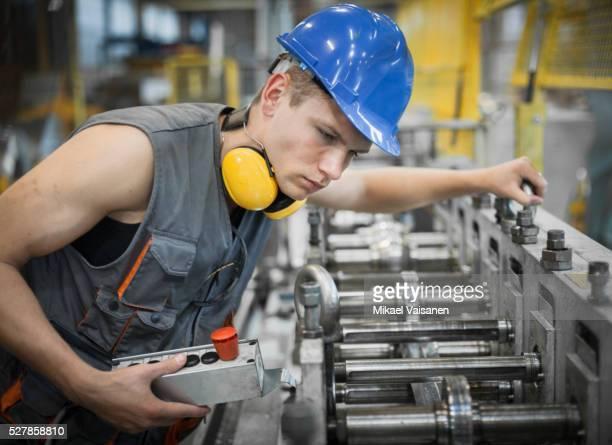 industrial worker in sheet metal component factory