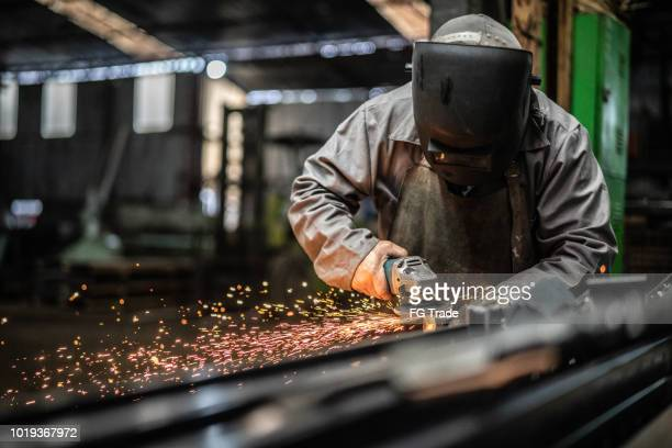 industrial worker welding steel - steelmaking stock photos and pictures