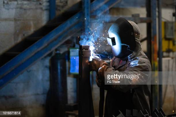 industrial worker welding steel - physical structure stock pictures, royalty-free photos & images
