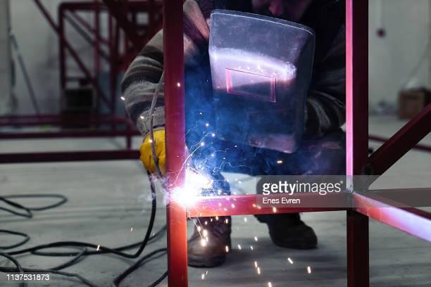 Industrial Worker welding steel