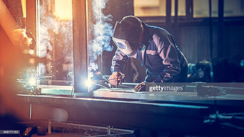 Industrial worker with welding tool : Stock Photo
