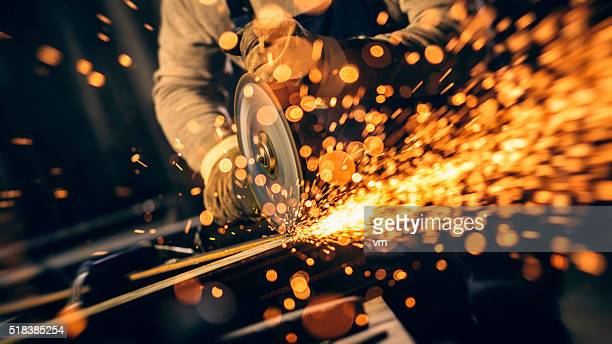 industrial worker with work tool - metallic stock photos and pictures