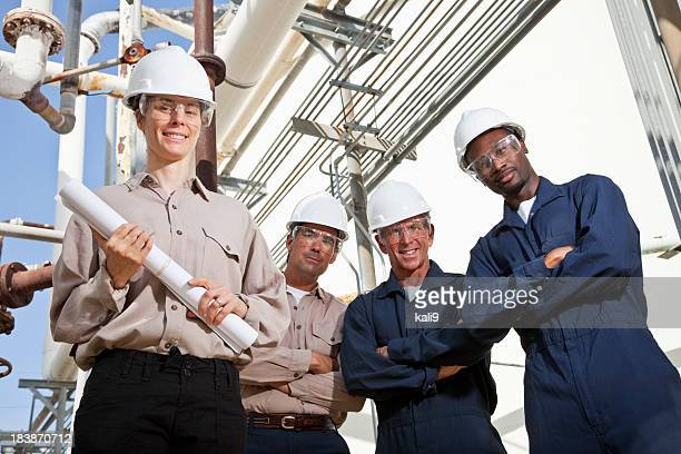 Industrial workers at manufacturing plant