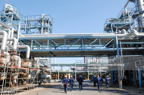 Industrial workers on oil and gas refinery