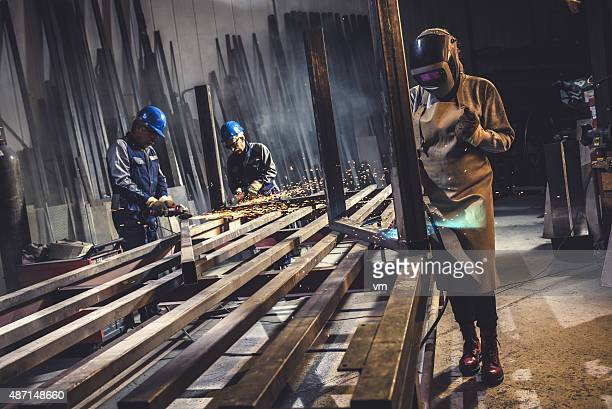 Industrial workers with welding tools