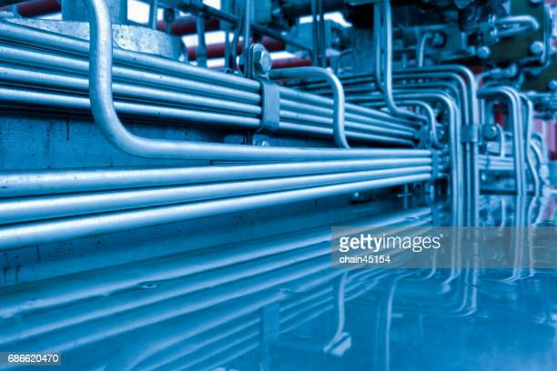 Industrial zone, Steel pipelines and valves in crude oil industry factory.