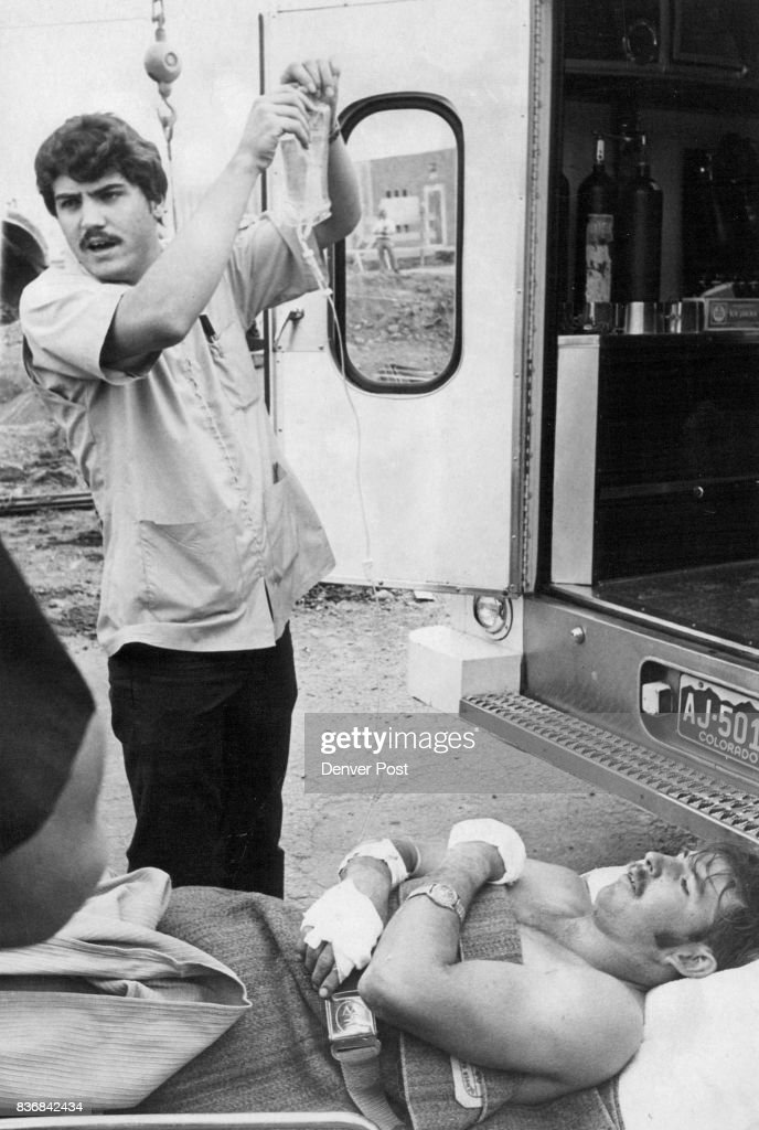 Industrial-Accident Victim Tended Dick wire. He received burns on his hands and legs while Olmsted, who was standing nearby, suffered minor injuries from the electrical shock. Credit: Denver Post