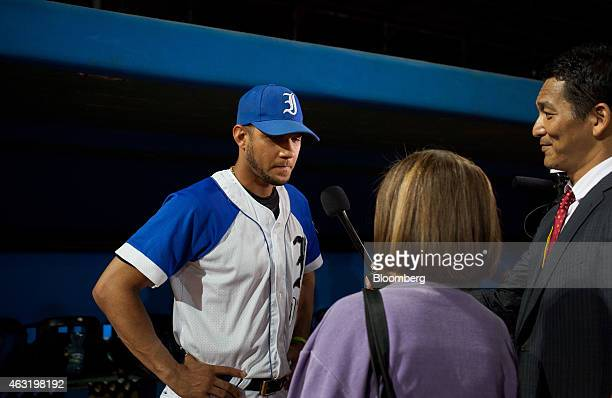 Industriales baseball player Yulieski Gourriel left speaks with reporters before the start of a game at El Latinoamericano stadium in Havana Cuba on...
