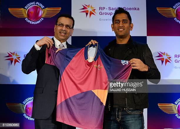 Industrialist and owner of the Indian Premier League's Rising Pune Supergiants cricket team Sanjiv Goenka and team captain Mahendra Singh Dhoni...