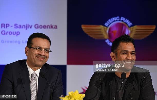 Industrialist and owner of the Indian Premier League's Rising Pune Supergiants cricket team Sanjiv Goenka and team captain Mahendra Singh Dhoni speak...