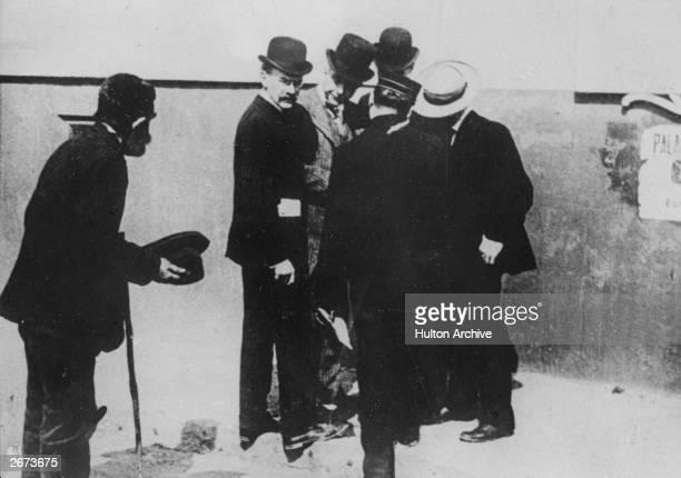 US industrialist and philanthropist John Davison Rockefeller in conversation with fellow businessmen ignores an old beggar's plea for charity This...