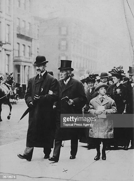 US industrialist and philanthropist John Davison Rockefeller walking in New York with a companion