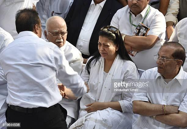 Industrialist Anil Ambani consoles Pratibha Advani during the funeral of Kamla Advani wife of senior BJP leader LK Advani at Nigambodh Ghat on April...
