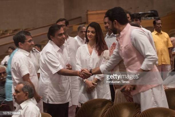 Industrialist Mukesh Ambani with Bollywood actors Aishwarya Rai Bachchan and Abhishek Bachchan at the prayer meet of former mayor of Mumbai and...