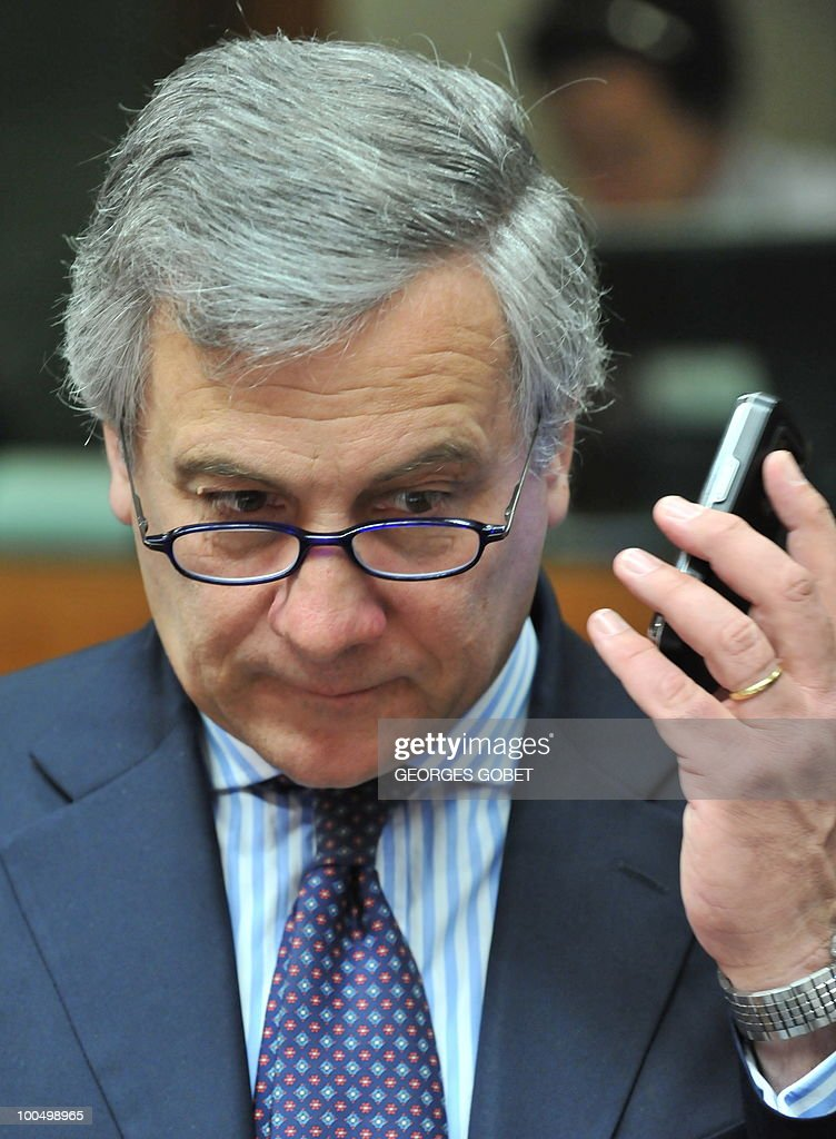 EU industry and entrepreneurship commssioner Antonio Tajani holds his cellular telephone on May 25, 2010 before the start of a Competitiveness Council meeting at EU headquarters in Brussels.