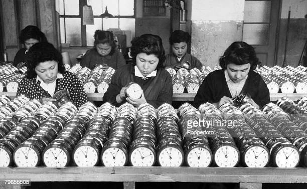 circa 1947 Workers busy making mass produced alarm clocks part of Japan's post war recovery