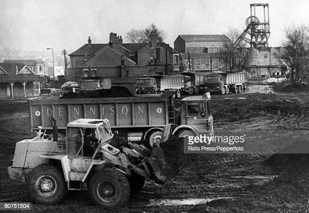 1974 Coal lorries waiting to be loaded at Glass Houghton Colliery near Castleford Yorkshire where coal supplies began to move again in anticipation...