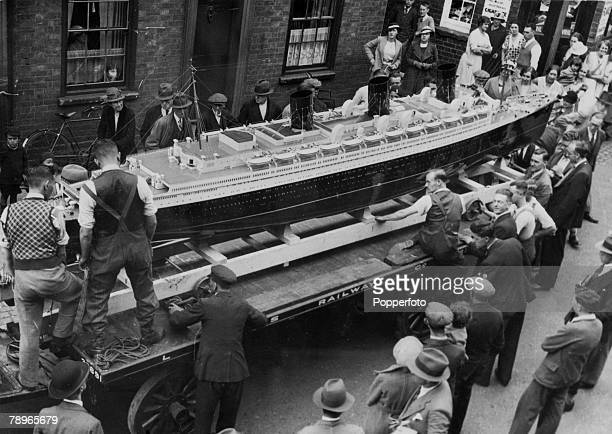 circa 1930's Northampton Northamptonshire England The BassettLowkes model of the Queen Mary pictured on the LMS dray leaving the works for the USA