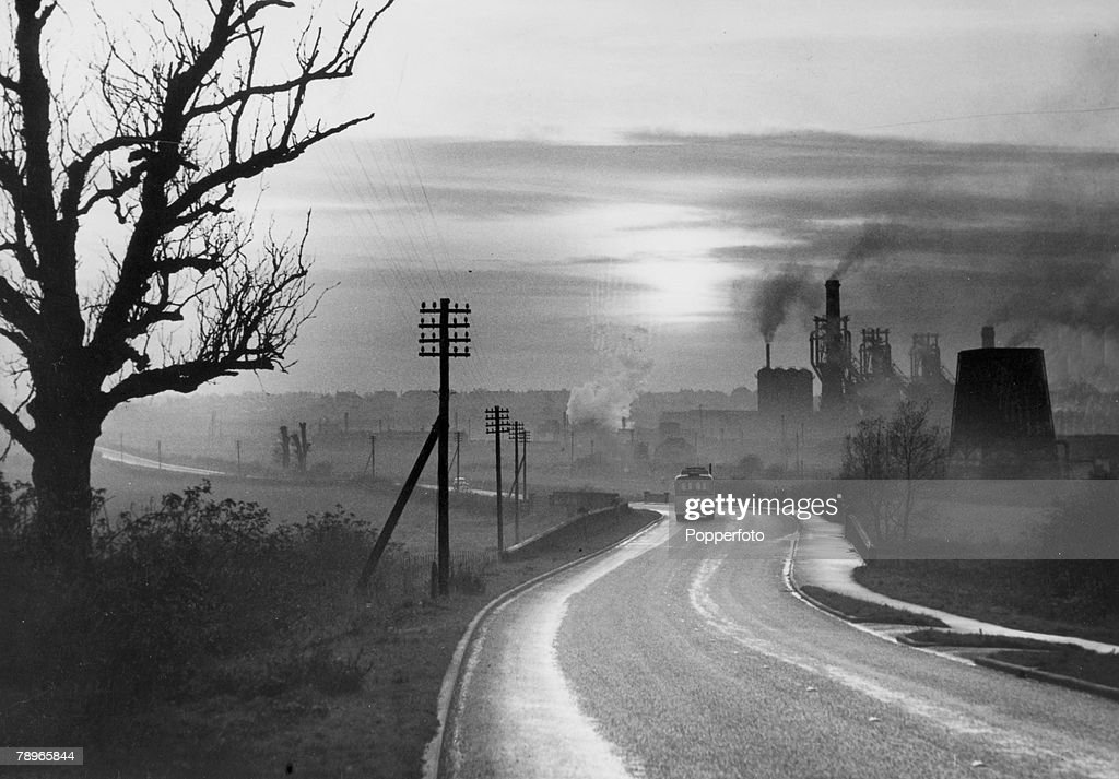 Industry. Northamptonshire, England. pic: circa 1950. A view from the Finedon - Wellingborough road, showing the blast furnaces at Wellingborough. : News Photo
