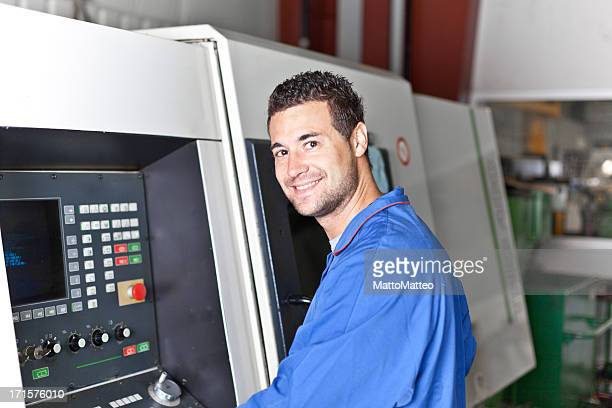 Industry worker in front of a turning machine