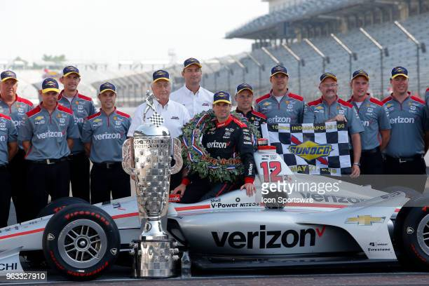 Indy 500 Champion Will Power of Team Penske with his Verizon team with Sunoco hats during the Indianapolis 500 Winners photo shoot on May 28 at the...
