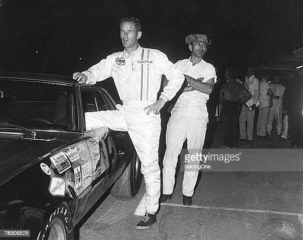 Indy 500 winner and sometimes stock car driver Bobby Unser prepares to climb into Henry Smokey Yunick's 1969 Z28 Camaro for the start of the Paul...