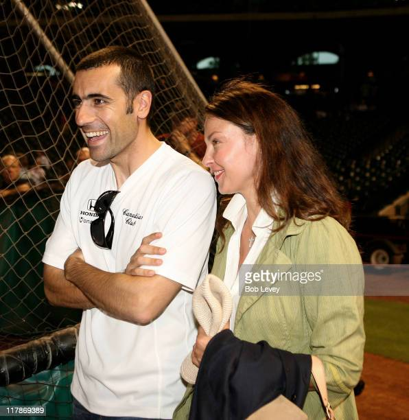 Indy 500 winner Dario Franchitti and his wife actress Ashley Judd watches batting practice before the Reds and Astros game May 30 2007 at Minute Maid...