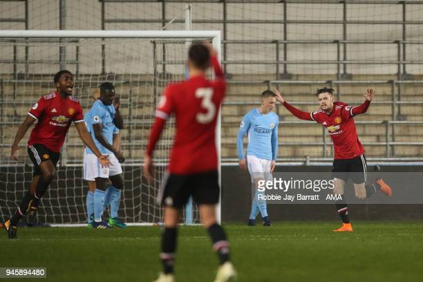 Indy Boonen of Manchester United celebrates after scoring a goal to make it 11 during the Premier League 2 match at Manchester City Football Academy...