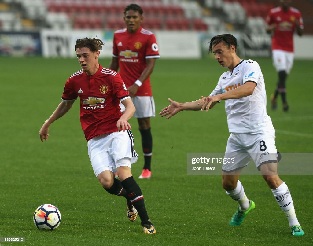 Indy Boonen of Manchester United U23s in action with Jack Evans of Swansea City during the Premier League 2 match between Manchester United U23s and Swansea City U23s at Leigh Sports Village on August 21, 2017 in Leigh, Greater Manchester.