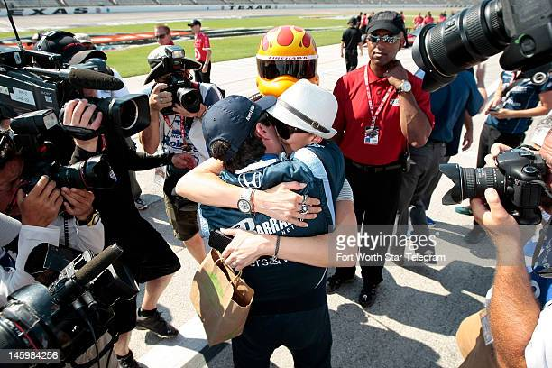 Indy Car driver Alex Tagliani is congratulated by his wife Bronte after he won the pole position during qualifying for the Firestone 550 at Texas...