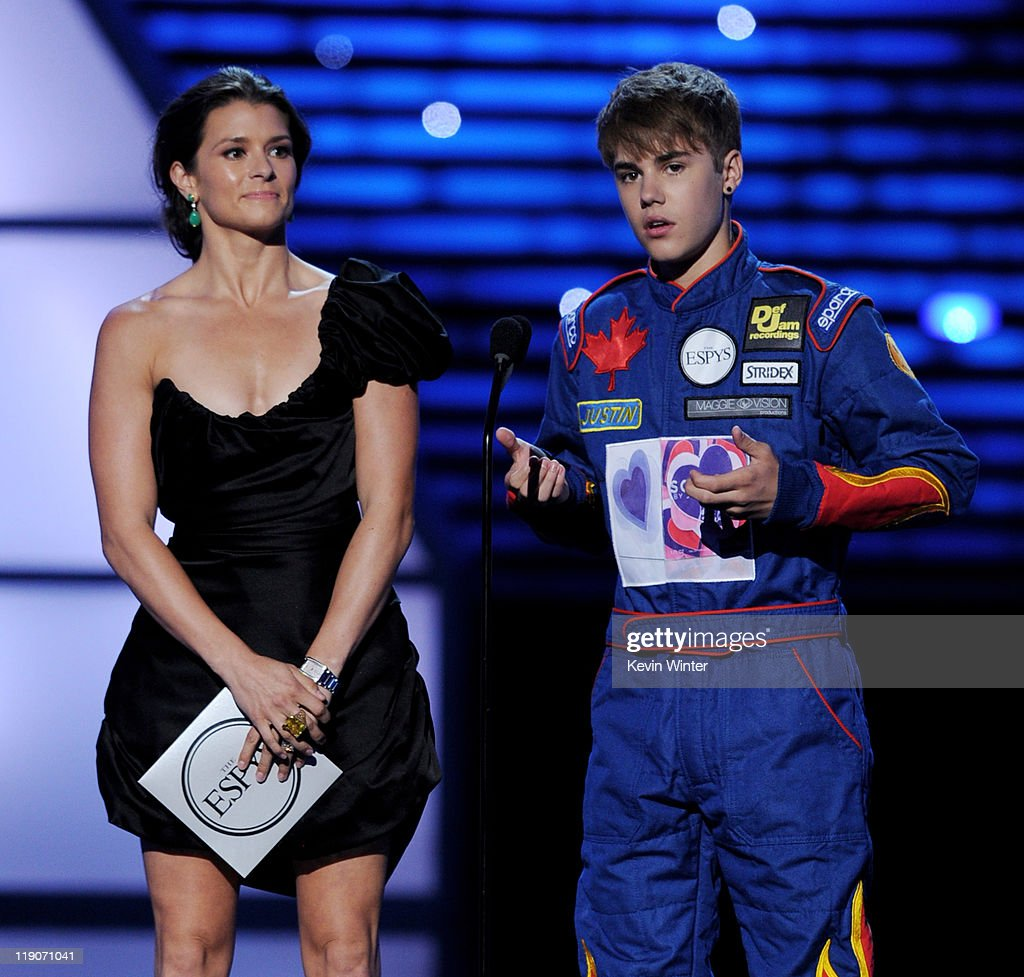 Indy Car driver Danica Patrick (L) and singer/musician Justin Bieber appear onstage to present Best Team at the The 2011 ESPY Awards at the Nokia Theatre L.A. Live on July 13, 2011 in Los Angeles, California.