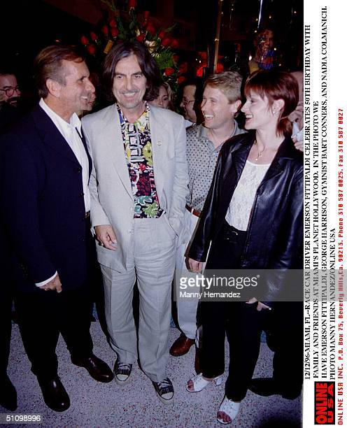Indy car driver Emerson Fittipaldi celebrates his 50th Birthday with friends George Harrison Bart Conner and Nadia Comaneci on December 12 1996 at...
